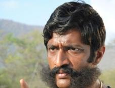 Kishore Photos
