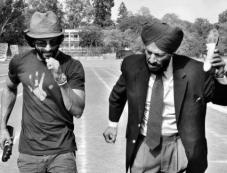 Farhan Akhtar and Milkha Singh still from on the sets of film haag Milkha Bhaag Photos