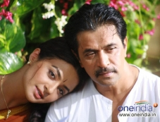 Surveen Chawla and Arjun Sarja in Kannada Movie Abhimanyu Photos