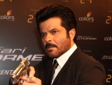 Anil Kapoor holding gun for a pose during the launch of Anil Kapoor's 24 series Photos
