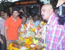 Hrithik Roshan with his father Rakesh Roshan celebrates Ganesh Visarjan 2013 Photos