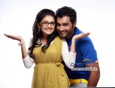 Saranya Mohan and Krish J. Sathaar in Malayalam Movie Thakkali Photos