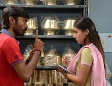 Dhanush and Nazriya Nazim Pics from Tamil Movie Naiyandi Photos