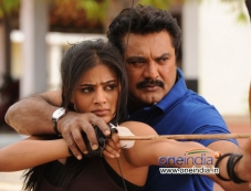 Priyamani and Sarathkumar still from film Anjatha Chandi Photos