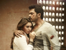 Hansika Motwani and Karthi still from film Biriyani Photos