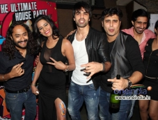 Poonam Pandey poses with the film What The Fish starcast Photos