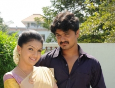 Saranya Mohan and Amal still from film Kolagalam Photos