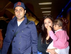 Aishwarya Rai and Abhishek Bachchan along with their daughter Aaradhya snapped at Airport Photos