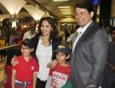 Madhuri and family return from their Sentosa Island/Sydney vacation Photos