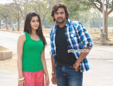 Nikki Galrani and Chiranjeevi Sarja in Kannada Movie Ajith Photos