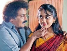 Ravichandran and Navya Nair in Drishya Photos