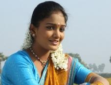 Priya in Porkalathil Oru Poo Photos