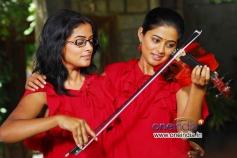 Priyamani in Double Role in Charulatha