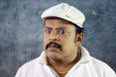 Madhil Mel Poonai