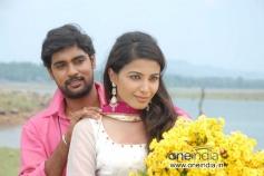 Mahesh and Kavya Shetty in Kannada Movie I am in Love