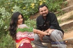 Nagaraj and Harshika Poonacha in Kannada Movie Maryade
