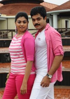 Sanjeev and Nandhana in Pink color Dress