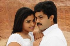 Sanjeev and Nandhana White Dress in Uyirukku Uyiraga