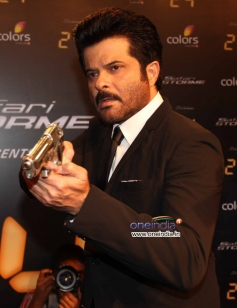 Anil Kapoor holding gun for a pose during the launch of Anil Kapoor's 24 series