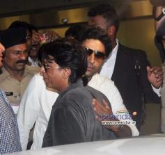 Abhishek Bachchan hugs Shahrukh Khan at Mumbai Airport