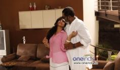 Asha Sharreth and Lal in Malayalam Film Zachariahyude Garbhinikal