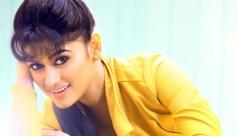 Oviya still from Madha Yaanai Koottam Movie