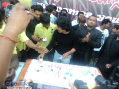 Upendra cuts his Birthday Cake surrounded by his fans at Palace Grounds, Bangalore