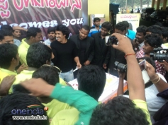 Upendra sharing sweets to his fans