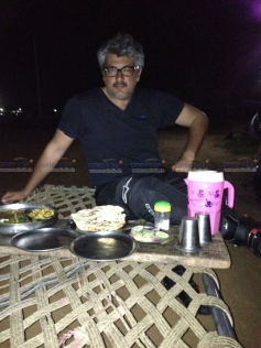 Ajith Kumar having dinner during his trip from Pune to Chennai in BMW K 1300 S bike