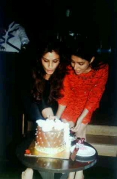 Birthday girl Asin cut her cake along with Raveena Tandon
