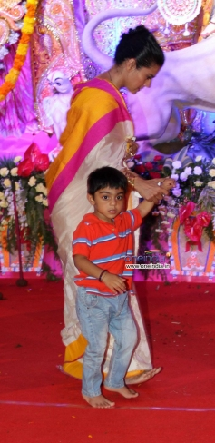 Kajol along with her son Yug Devgan at Juhu Durga pooja event 2013