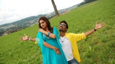 Dhanush and Nazriya Nazim Pics from Tamil Movie Naiyandi