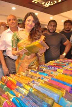 Kajal Aggarwal trying out saree at Chennai shopping mall