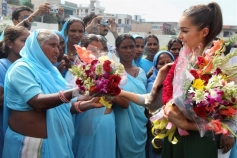 Miss Universe Olivia Culpo being welcomed during a visit to Sulabh Gram
