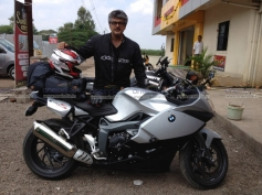 Ajith Kumar poses with his BMW K 1300 S bike