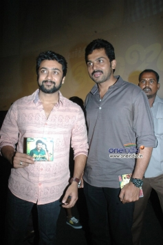 Suriya along with her younger brother Karthi holding All in All Azhagu Raja audio cd