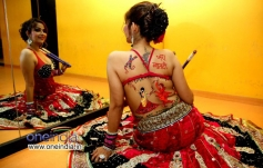 Tanisha Singh bareback pose showing her dandiya body paint