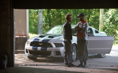 Aaron Paul and Kid Cudi still from film Need for Speed