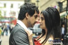 Pushkar Jog and Armeena Rana Khan romantic still from film Huff! - It's Too Much