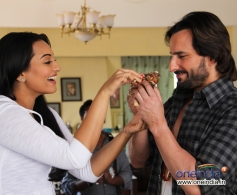 Sonakshi Sinha shares a piece of cake with Saif Ali Khan still from film Bullet Raja
