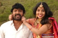 Vignesh and Devika still from film Poonai