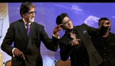 Amitabh Bachchan and Shahrukh Khan dance during an event celebrating 25 years of NDTV