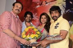 YVS Chowdary presenting flower pot to Naga Babu at Rey Teaser Launch