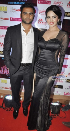 Sachiin Joshi poses with Sunny Leone during the Jackpot movie premiere