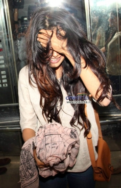 Sarah Jane Dias hides her face at the special screening of film The Wolf of Wall Street
