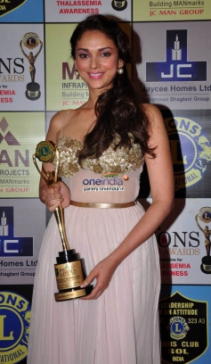 Aditi Rao Hydari poses with her award during the 20th Lions Gold Awards 2014