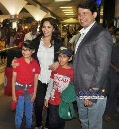 Madhuri and family return from their Sentosa Island/Sydney vacation
