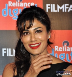 Chitrangada Singh poses with her cute smile during the launch of Filmfare 2014 calendar