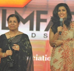 Nimrat Kaur accepts the award on behalf of Ritesh Batra, who won the Best Debut Director Award