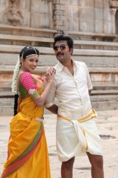 Oviya Helen and Prasanna still from film Pulivaal
